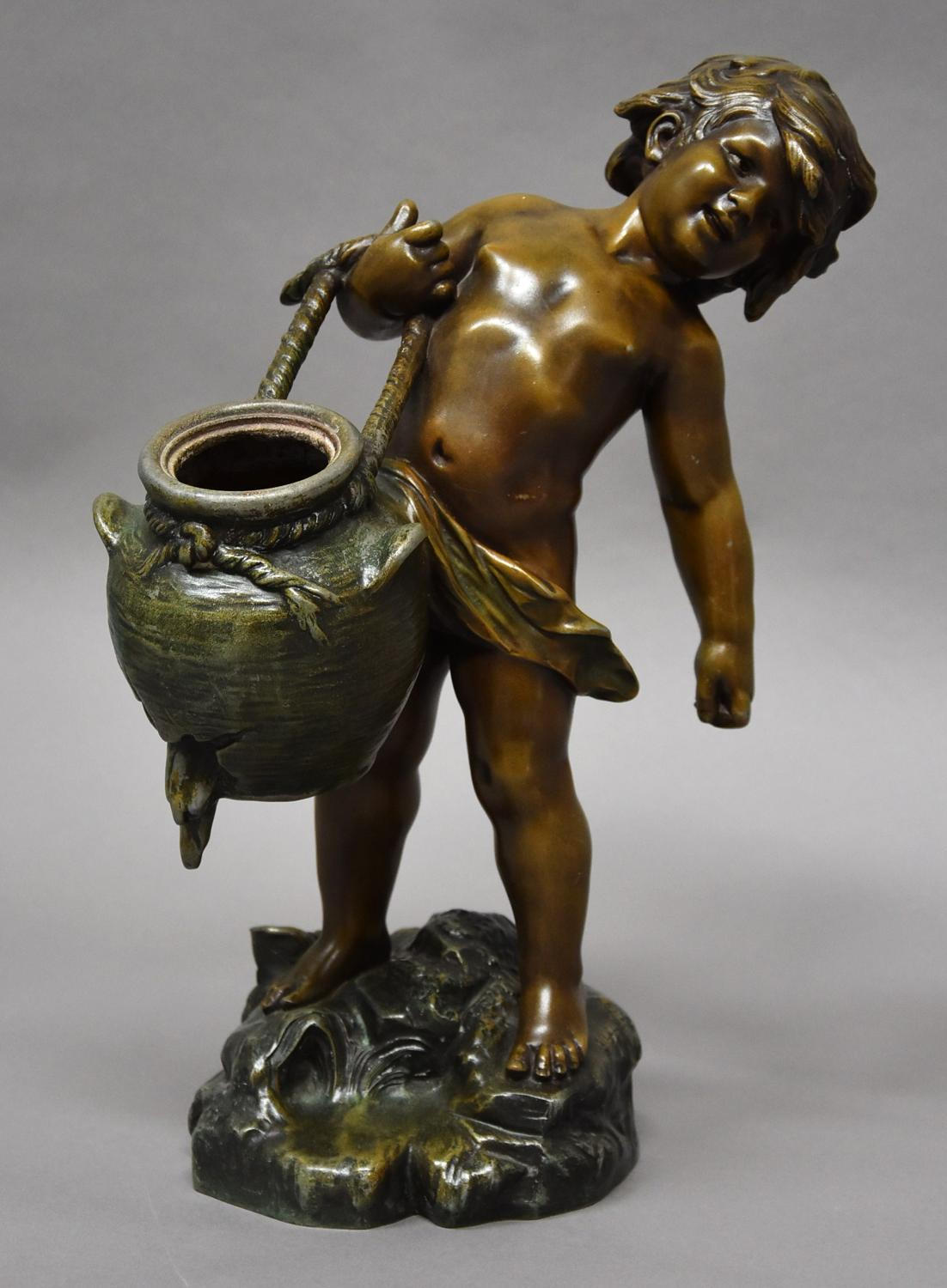 French patinated bronzed spelter figure of young male water carrier