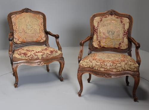 Pair of French fauteuils of large proportion with original needlework