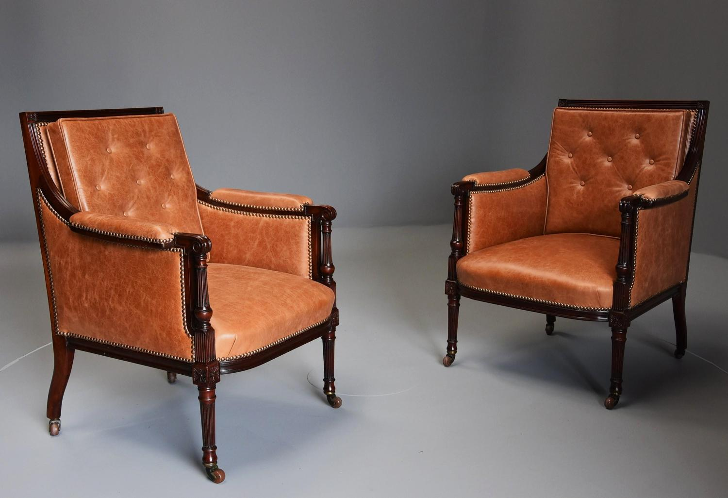 Superb pair of Sheraton style 'His & Hers' mahogany library chairs