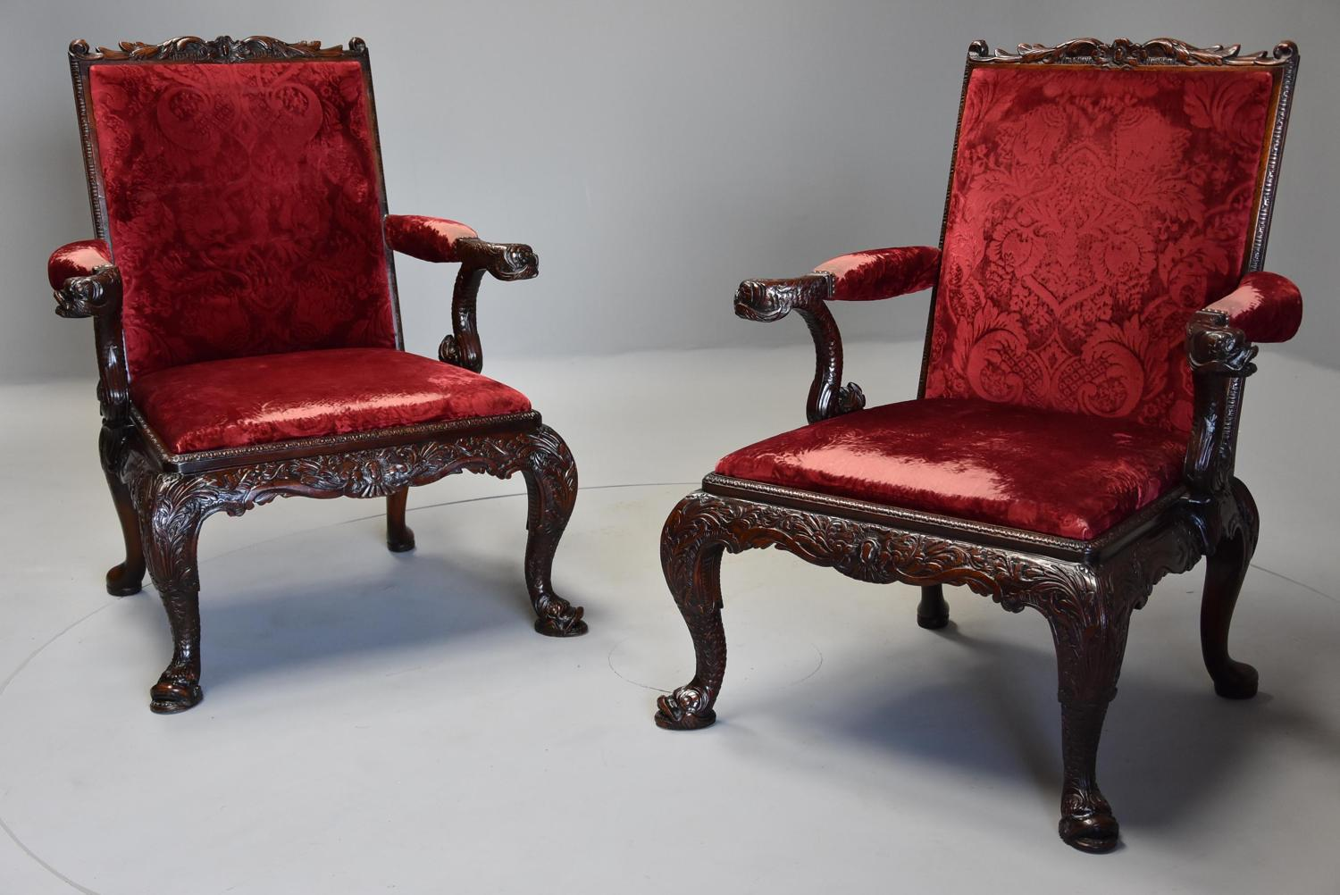 Superb pair of George II style mahogany Gainsborough armchairs