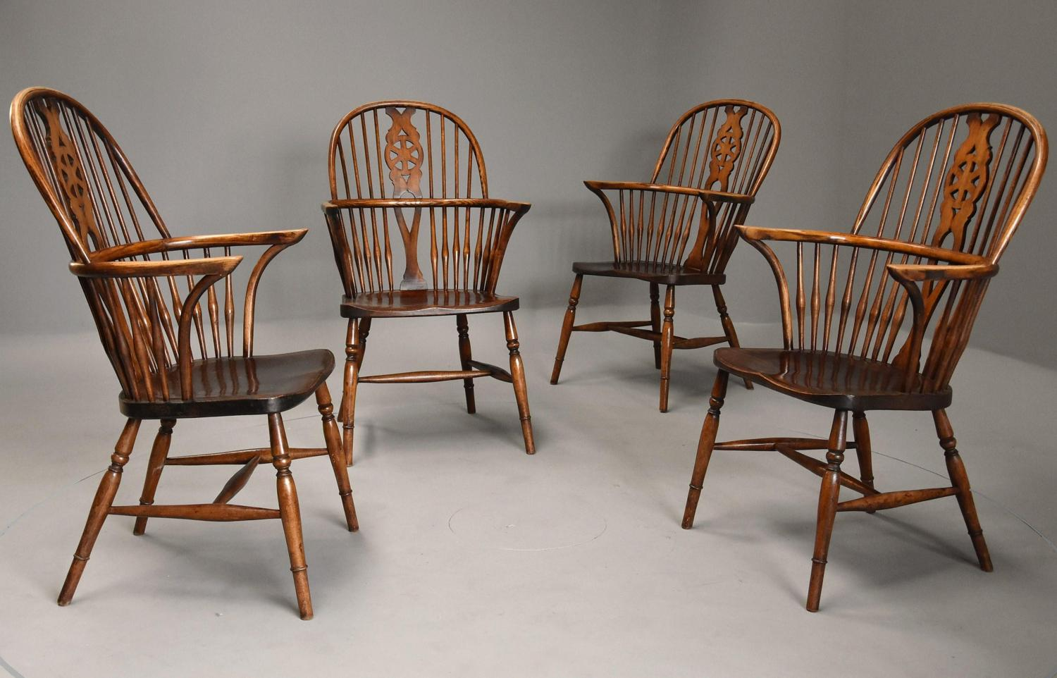 Set of four early 20th century ash and elm wheelback Windsor chairs