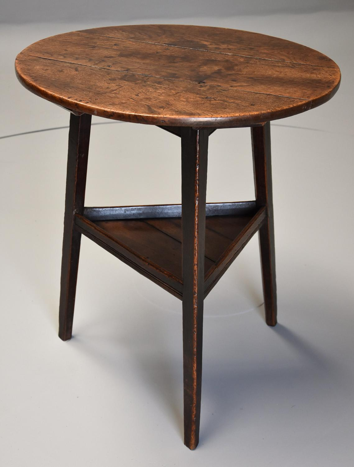 Late 18th century oak cricket table with shelf and of fine patina