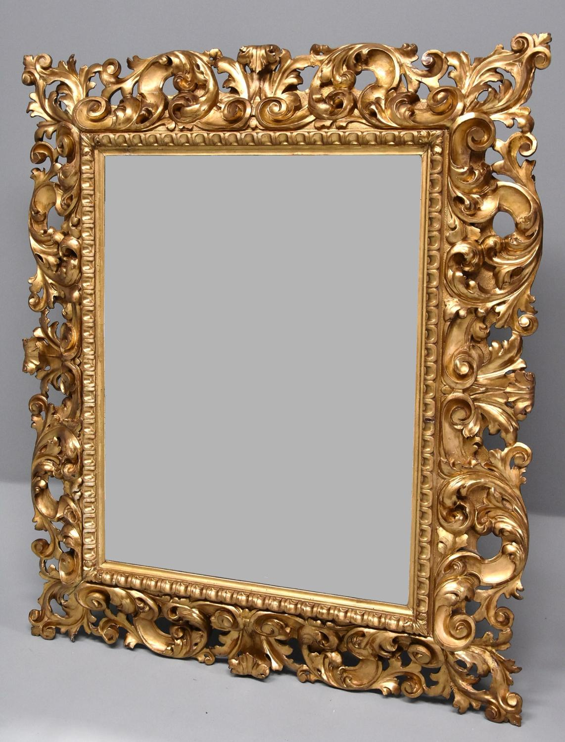 Large late 19th century Florentine carved gilt wood mirror