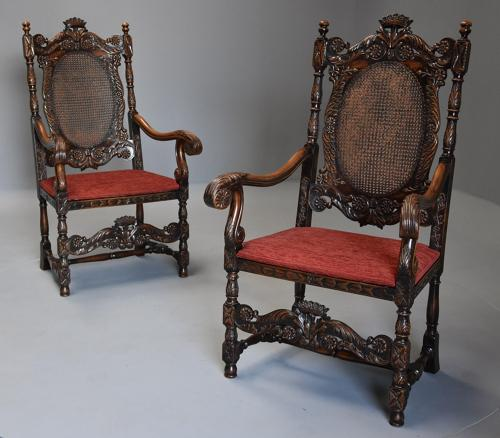Superbly carved pair of Charles II style walnut armchairs
