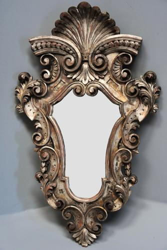Highly decorative 19thc Italian silver giltwood Rococo style mirror