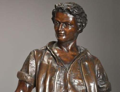 19thc large bronzed spelter figure of a farm labourer, signed Milliot