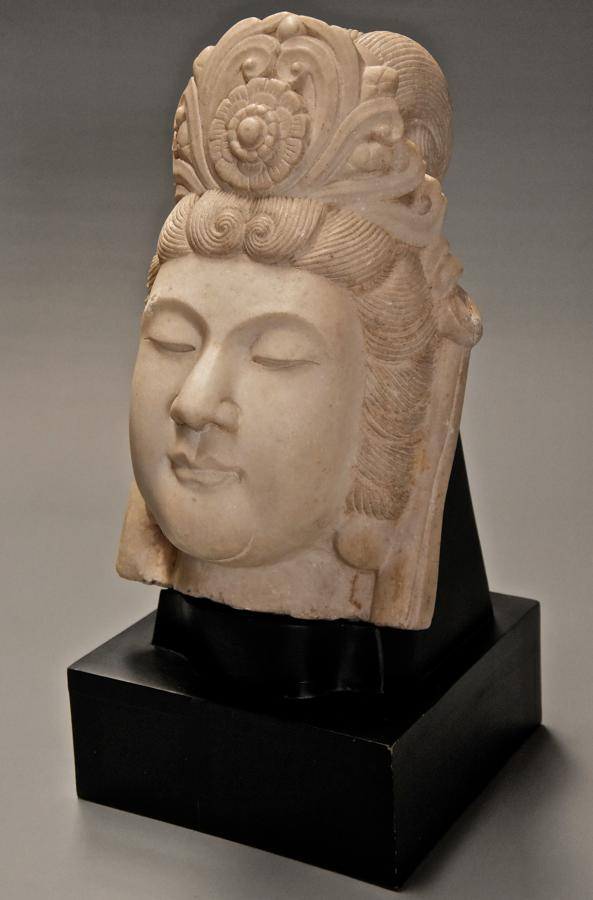 Late 19thc highly decorative carved marble head of Guan Yin