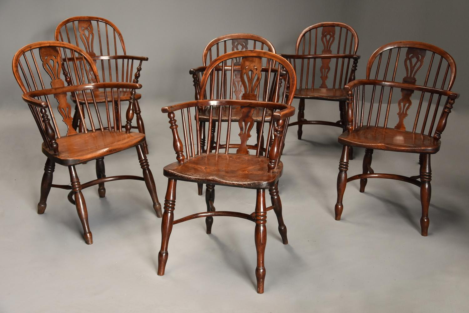 Mid 19thc well matched set of six yew wood low back Windsor armchairs