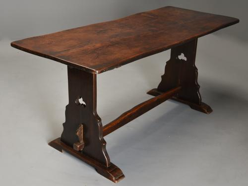Early 20thc Arts & Crafts oak pegged trestle table with superb patina