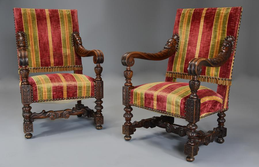 Fine pair of 19thc French walnut open armchairs in the Baroque style