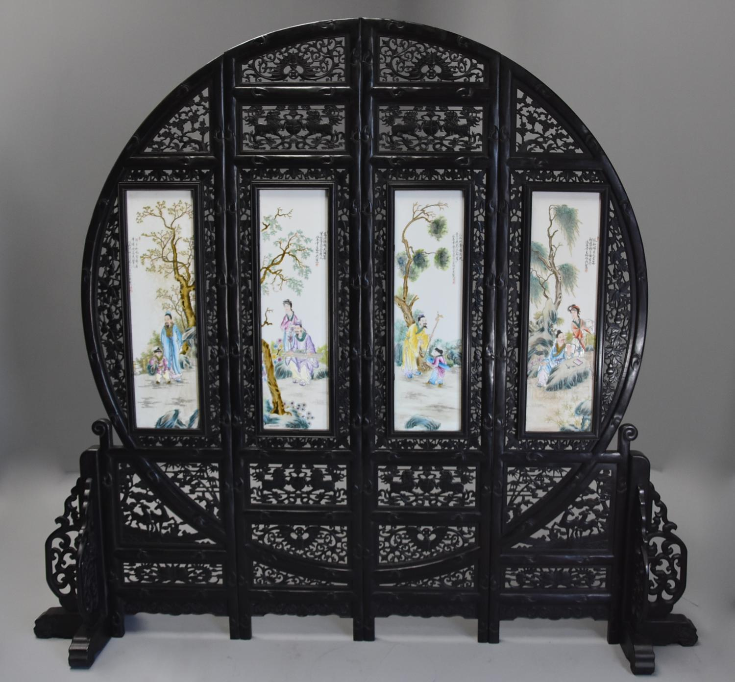 Highly decorative large Chinese carved hardwood four panel screen