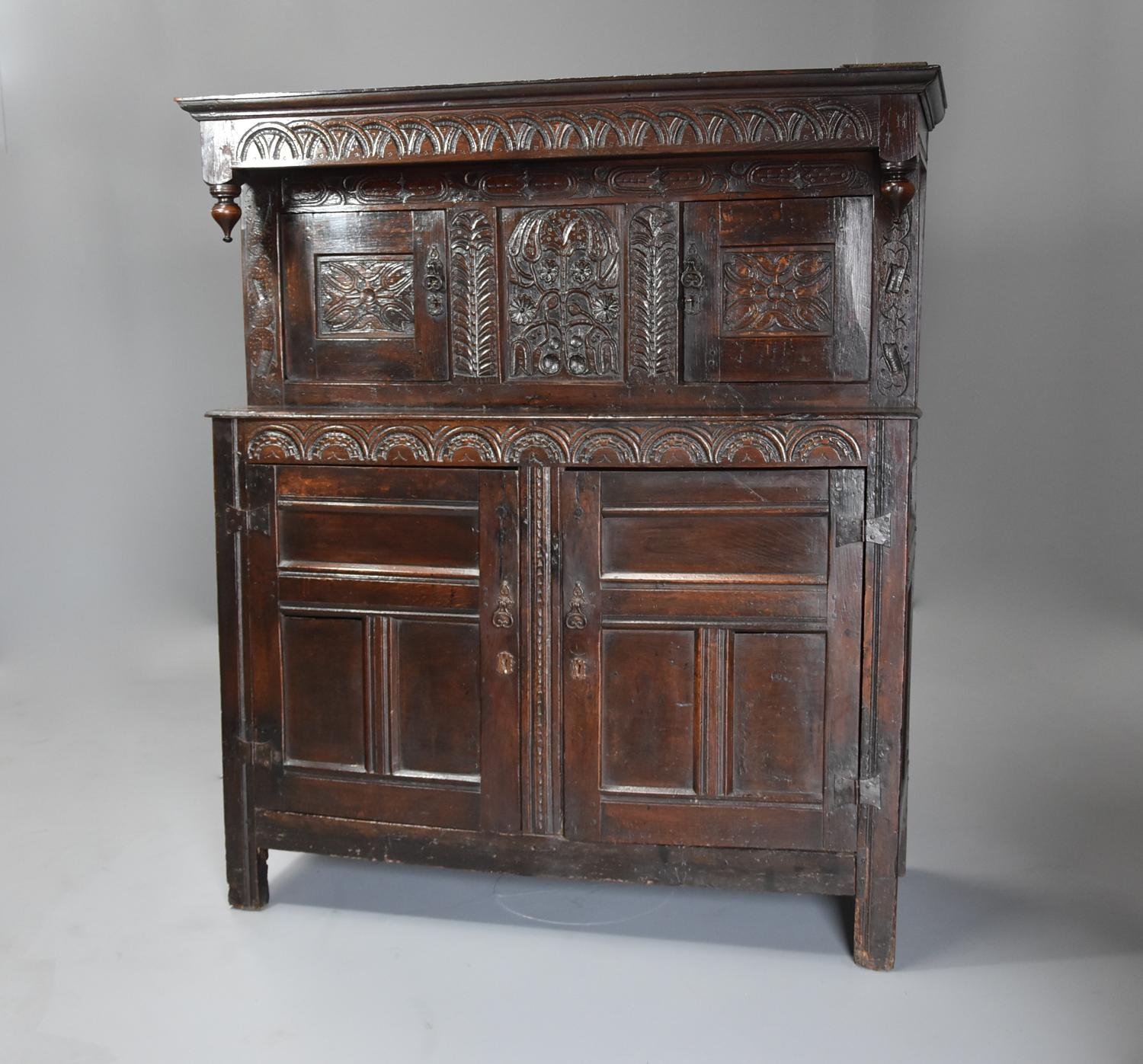 Wonderful mid 17thc carved oak press cupboard with superb patina