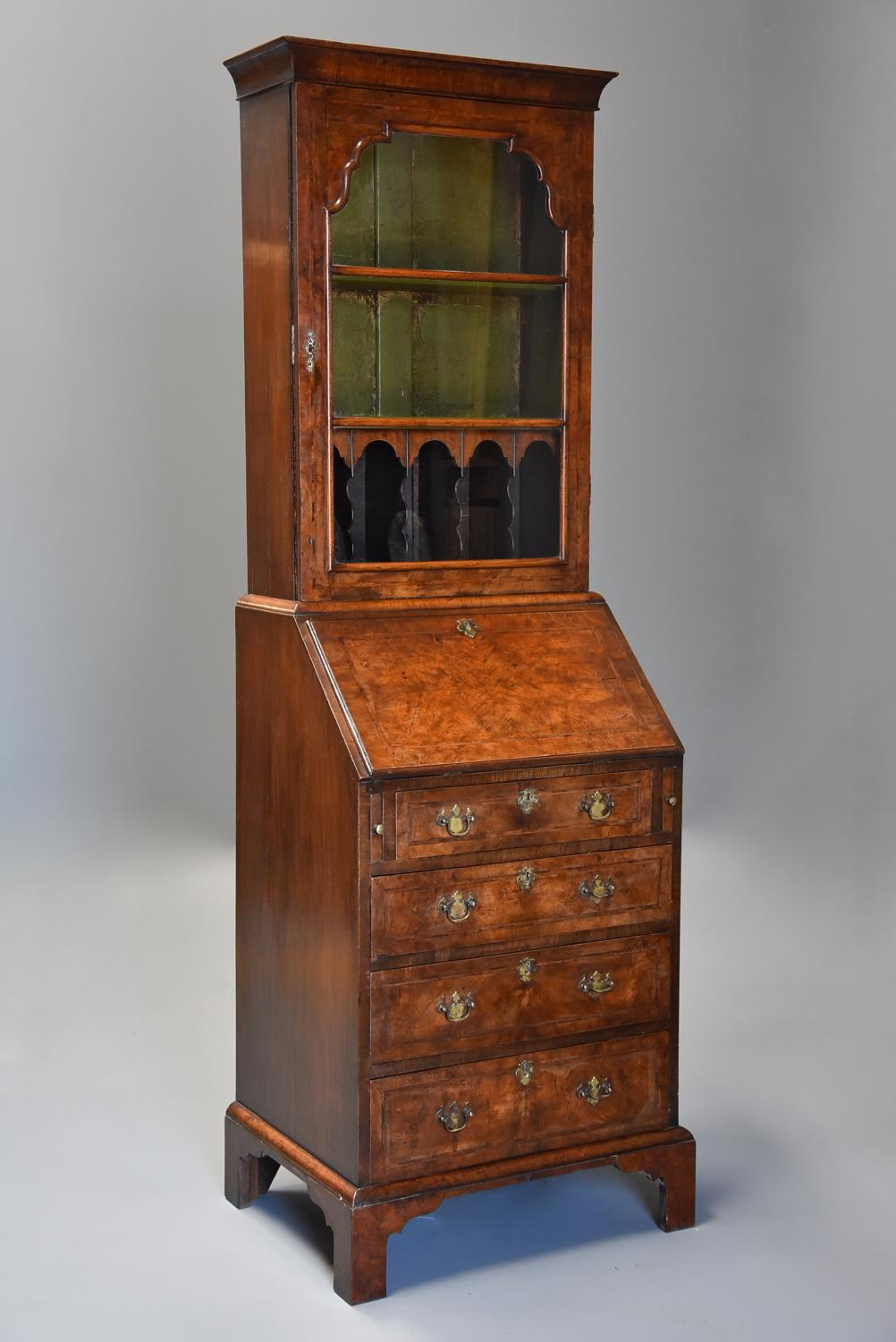 Queen Anne style walnut bureau bookcase of small proportions