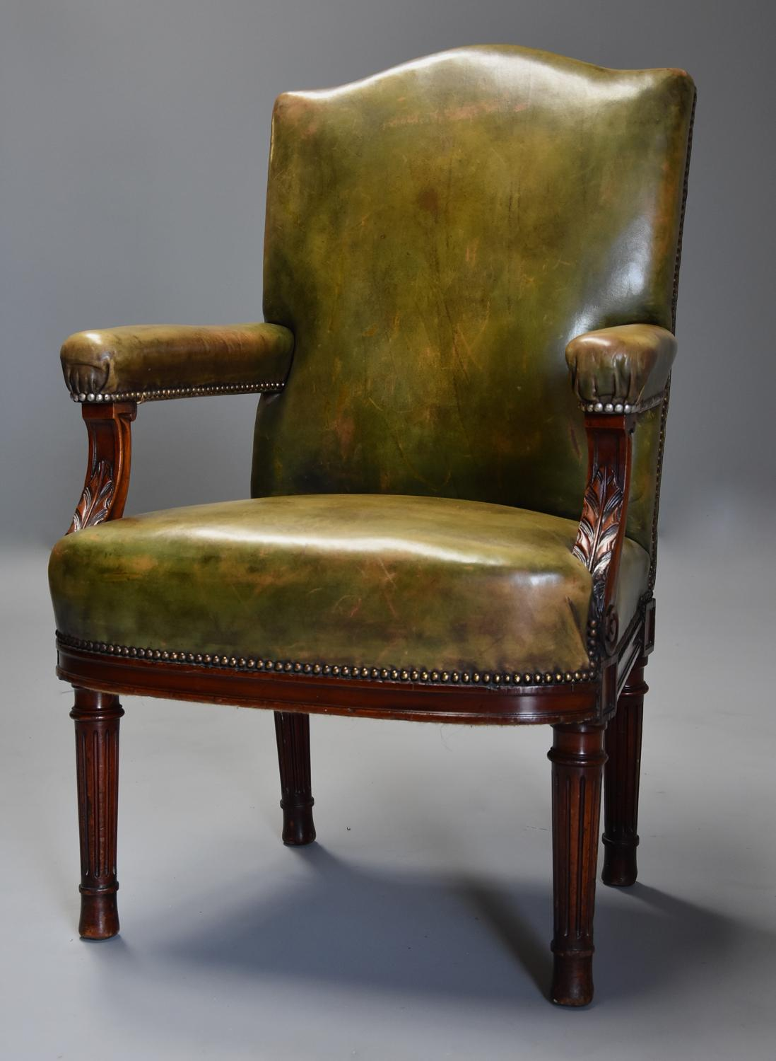 Late 19th century mahogany green leather open armchair