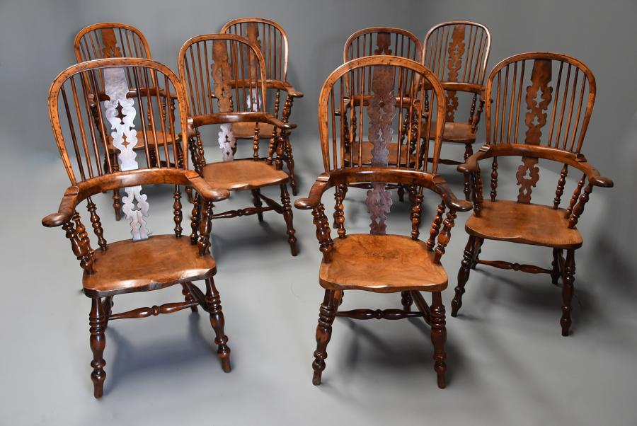 Superb set of eight 19thc broad arm burr yew high back Windsor chairs