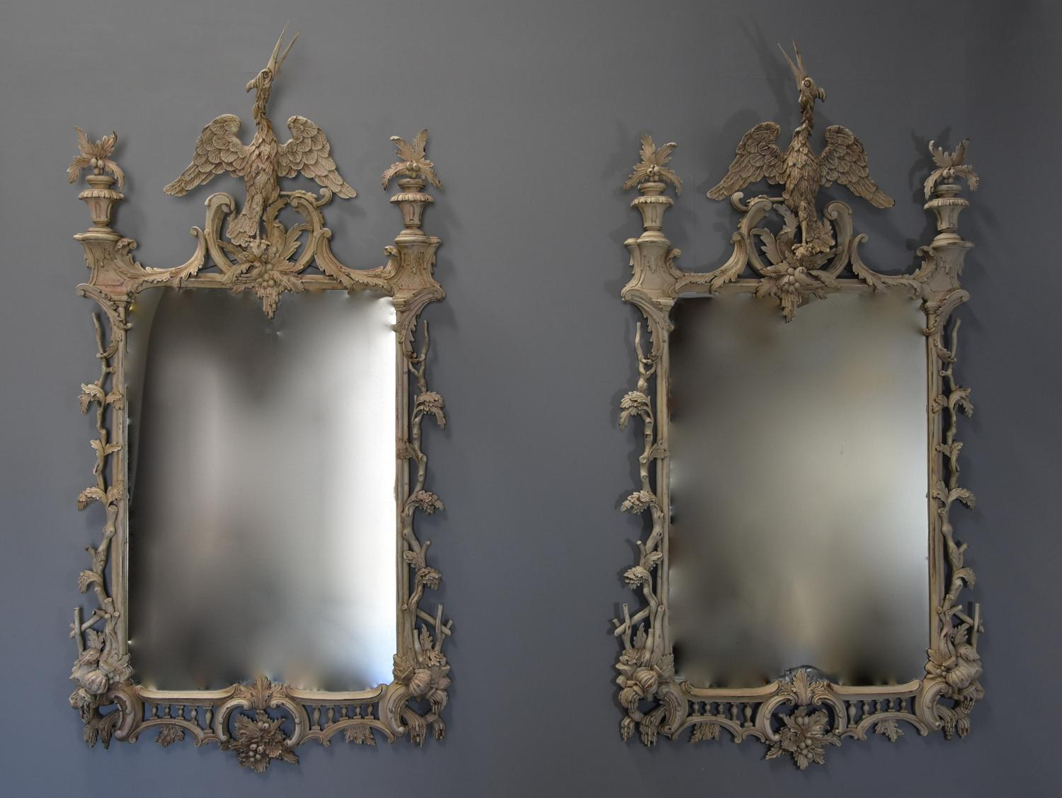 Pair of highly decorative Chippendale style carved wooden pier mirrors