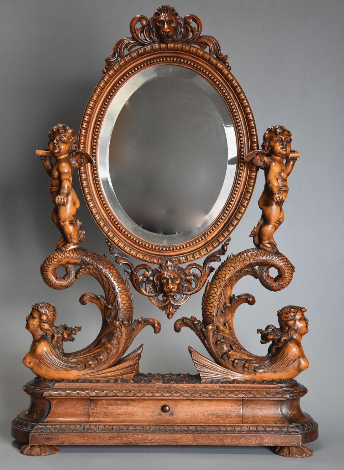 Exhibition quality superbly carved 19thc Italian limewood table mirror