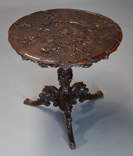 Late 19thc Black Forest carved linden wood centre table