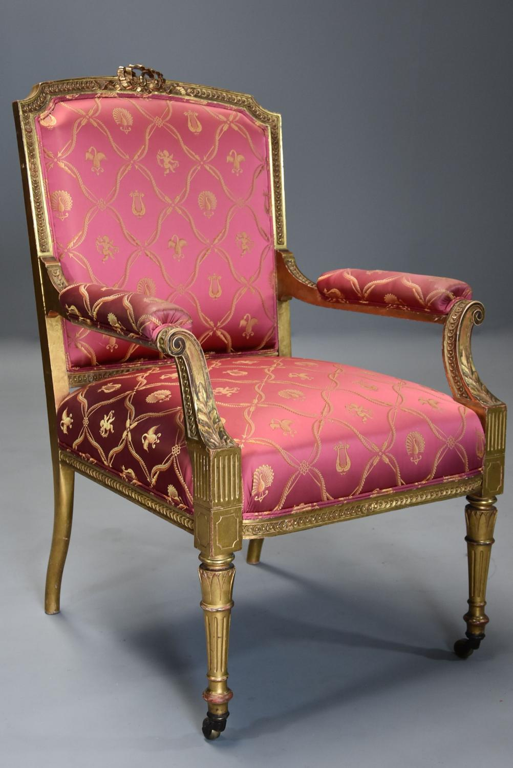 Late 19thc French carved giltwood open armchair of large proportions