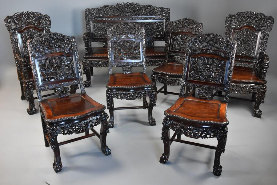 Superb quality 19thc Chinese profusely carved padouk seven piece suite