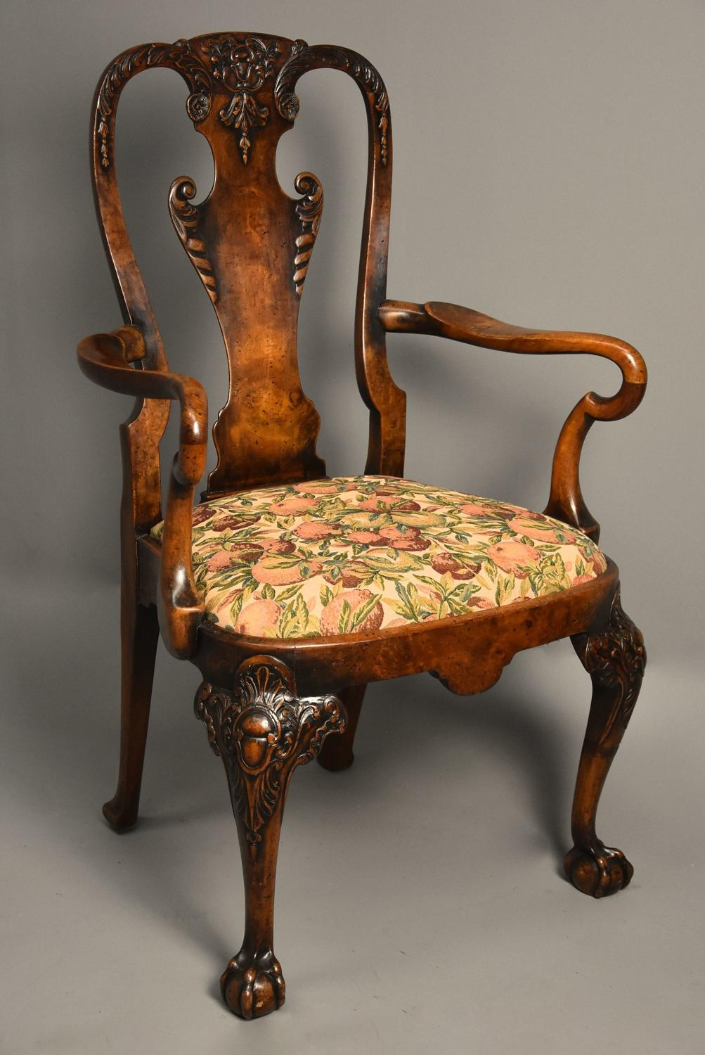 Early 20thc walnut armchair in the Queen Anne style of fine patina
