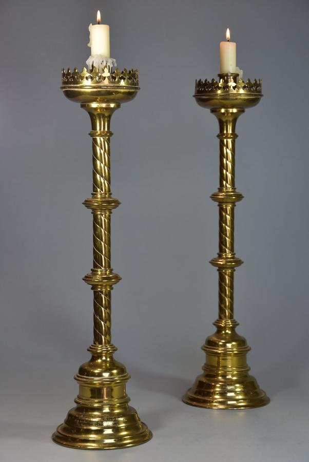 Pair of highly decorative late 19thc Gothic style brass candlesticks