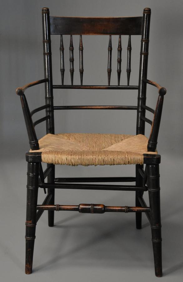 Late 19th century ebonised Sussex armchair attributed to Morris & Co.