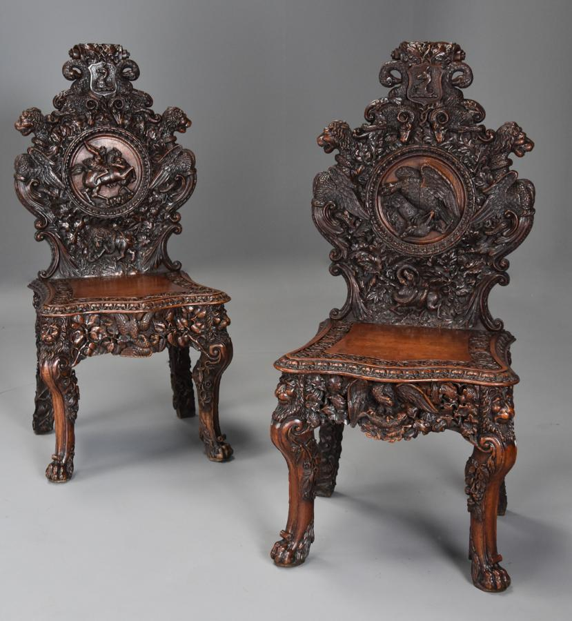 Pair of 19thc Exhibition quality carved oak chairs of large proportion