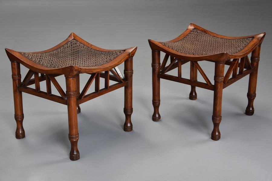 Pair of early 20thc walnut Thebes stools, designed by Liberty & Co