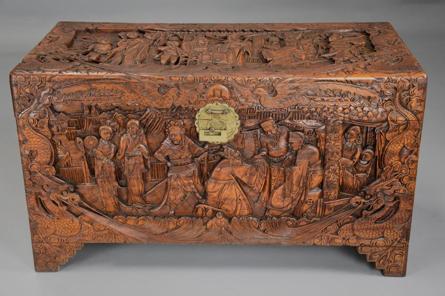 A highly decorative mid 20thc profusely carved Eastern camphor chest