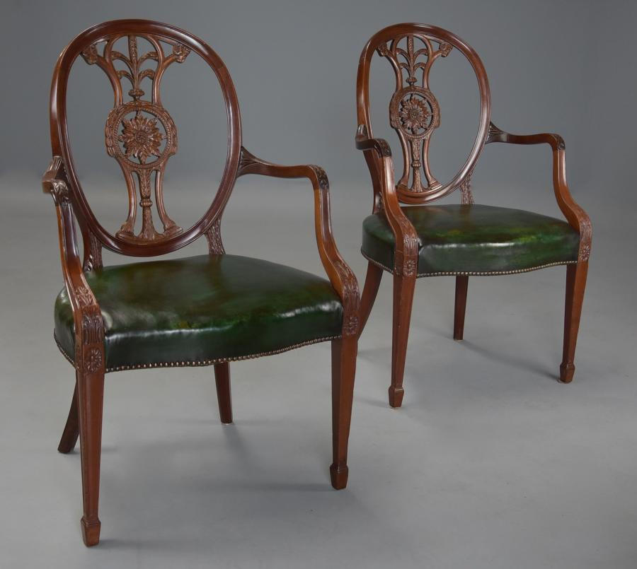 Pair of 19thc Hepplewhite style mahogany oval back open armchairs