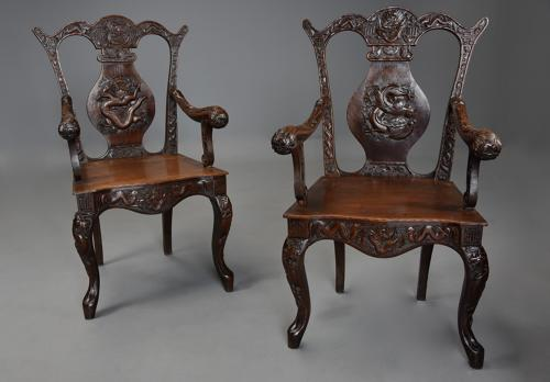 Pair of 19thc walnut armchairs of Chinese influence in the 18thc style