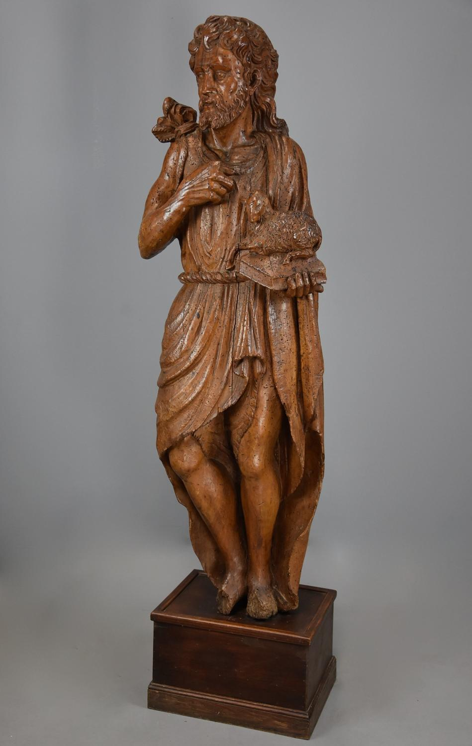 Large Continental 16thc carved limewood figure of St John the Baptist