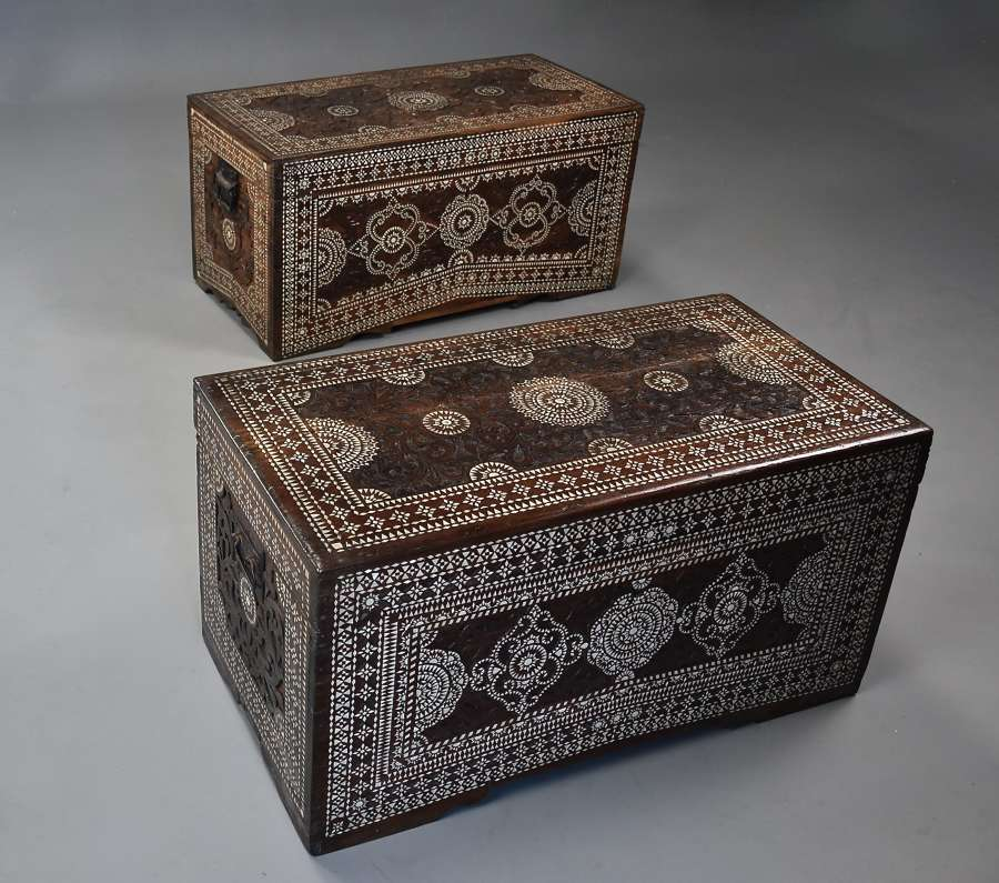 Highly decorative near pair of hardwood & mother of pearl trunks