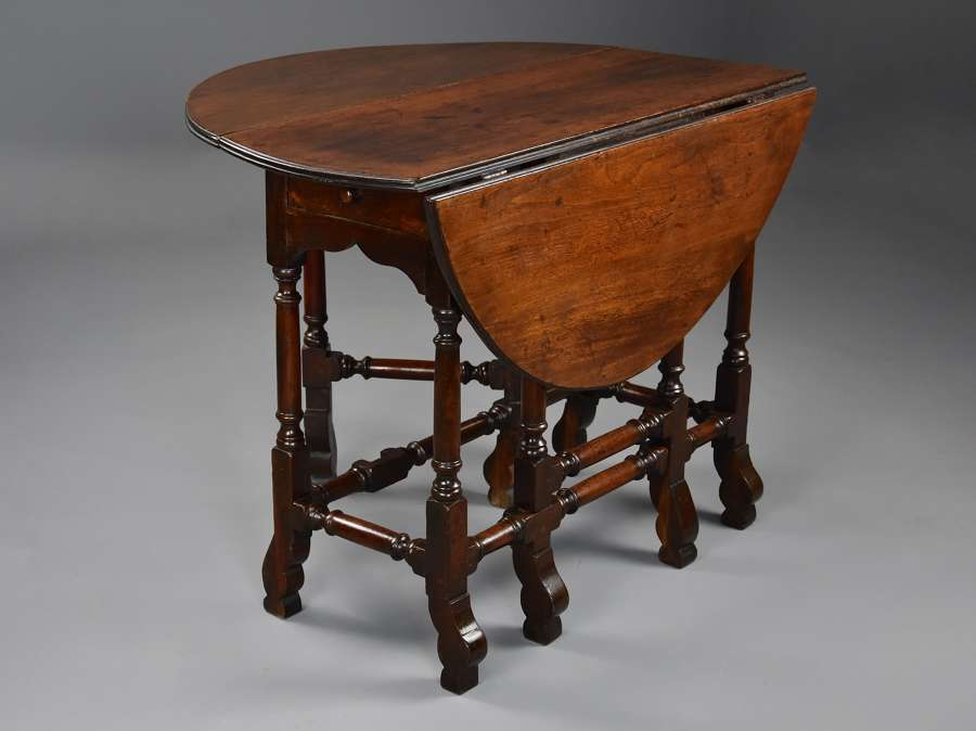 Rare 18thc red walnut gateleg table of small proportions & fine patina