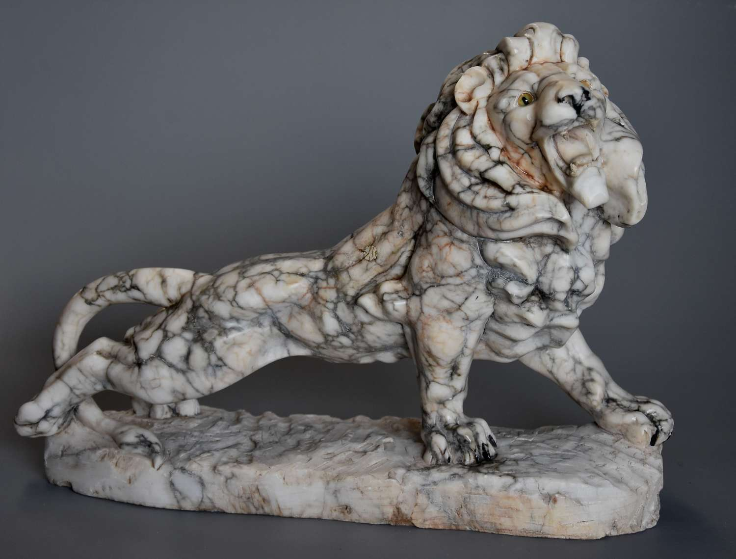Highly decorative French Art Deco carved marble sculpture of a lion