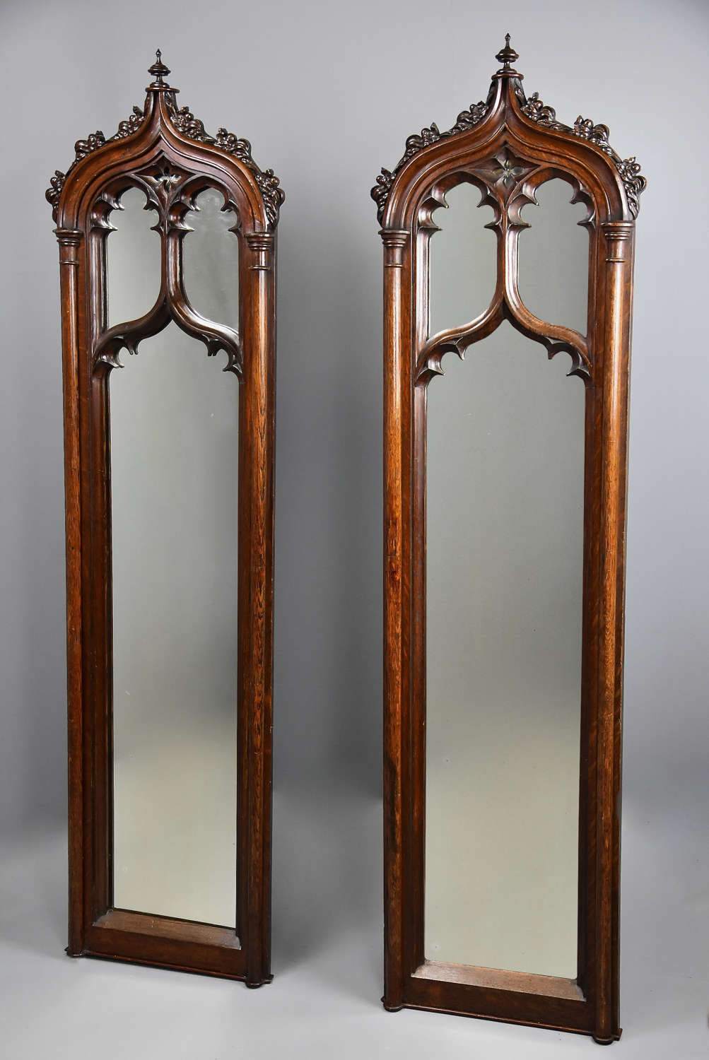 Fine pair of mid 19th century oak Gothic mirrors