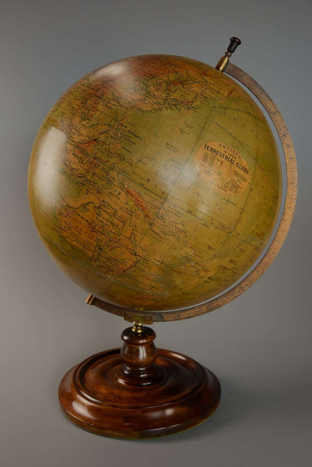 Early 20thc Philips 19'' terrestrial table globe on walnut base