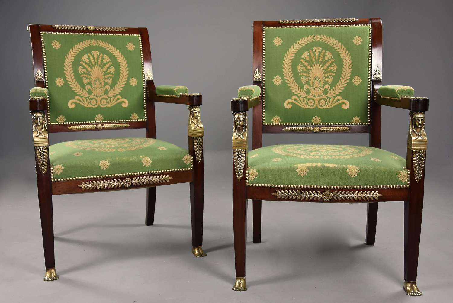 Pair of late 19thc French Empire style mahogany fauteuils