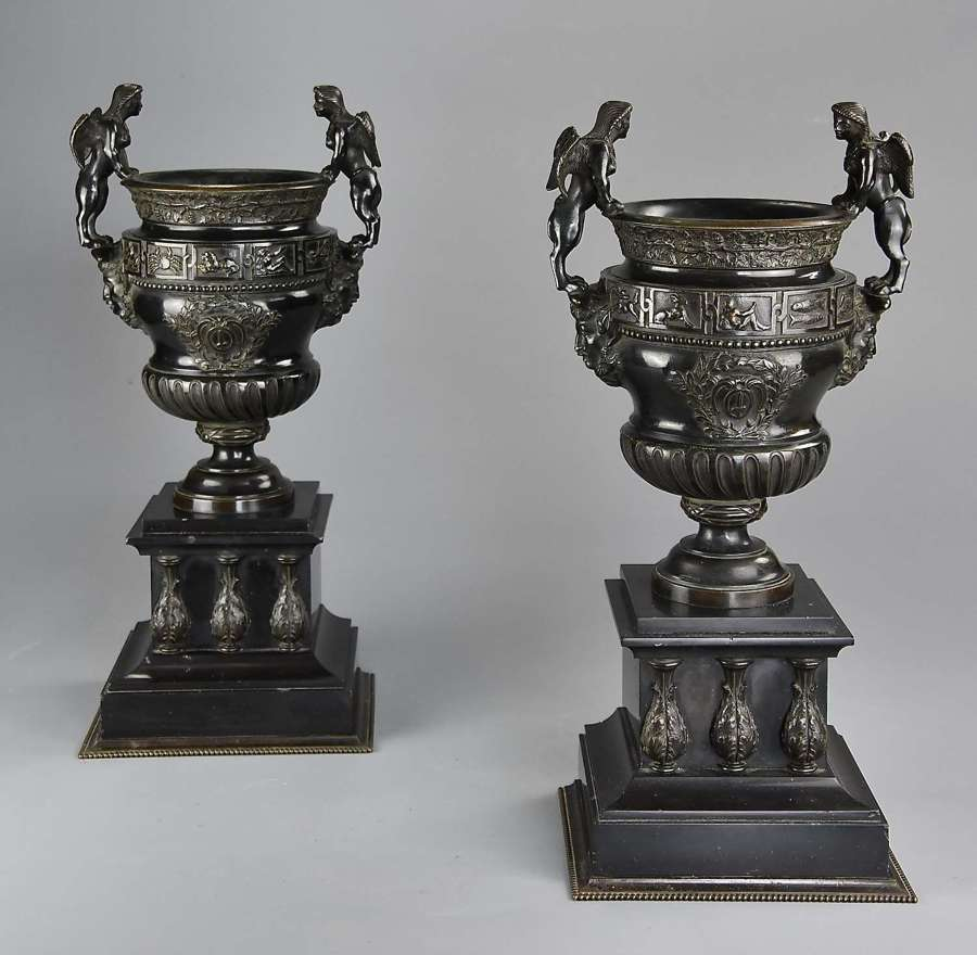 Pair of late 19thc bronze urns after a pair of urns at Versailles