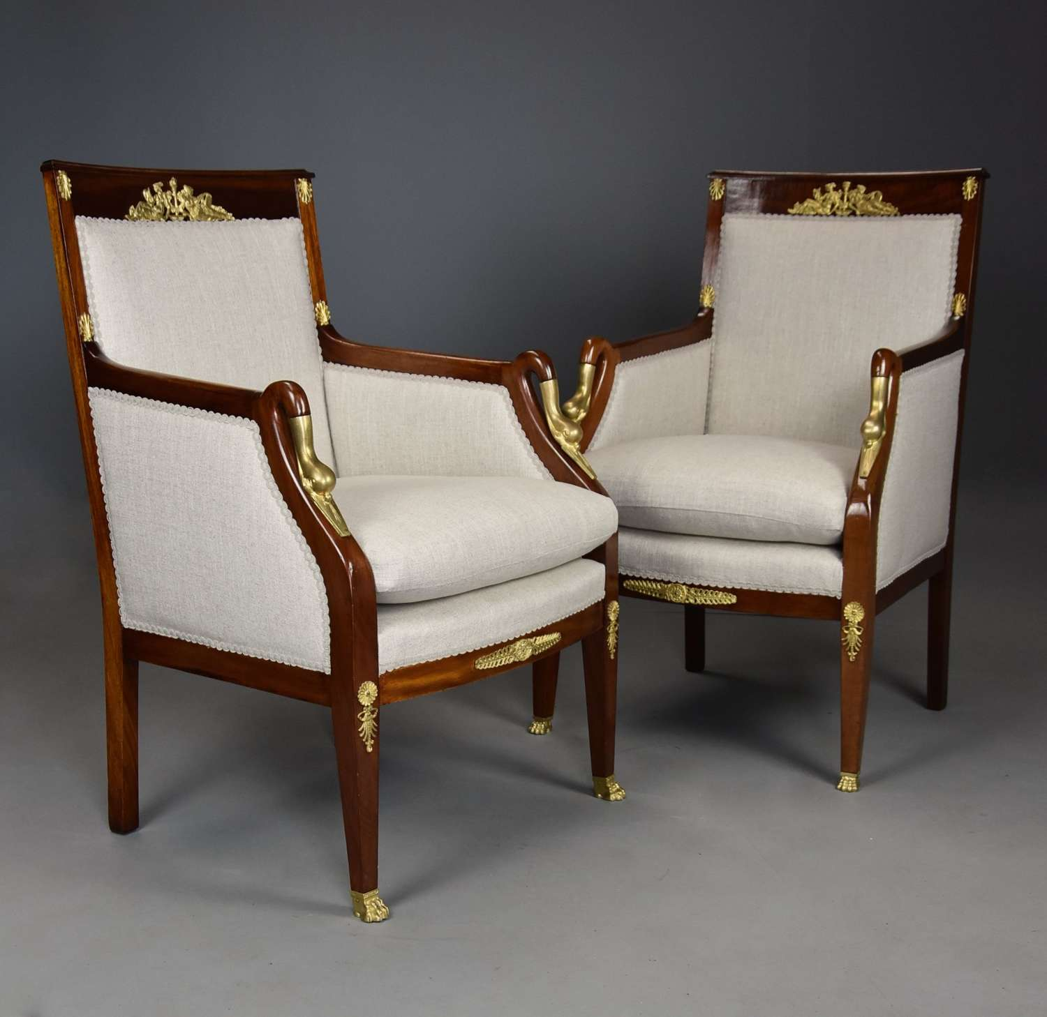 Pair of French Empire style mahogany upholstered armchairs