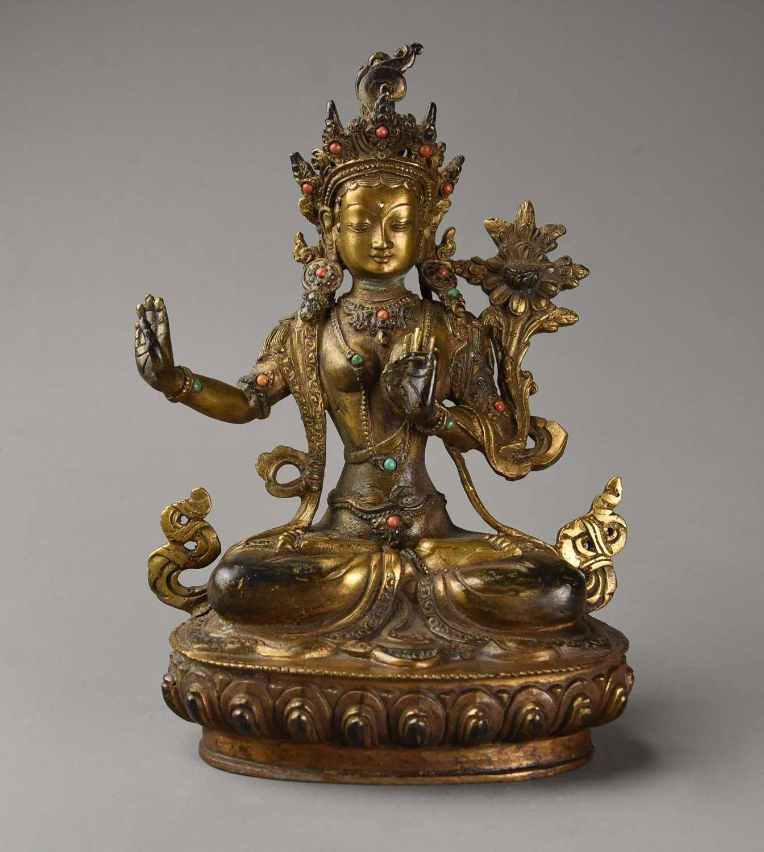 Highly decorative Chinese gilt metal Buddha