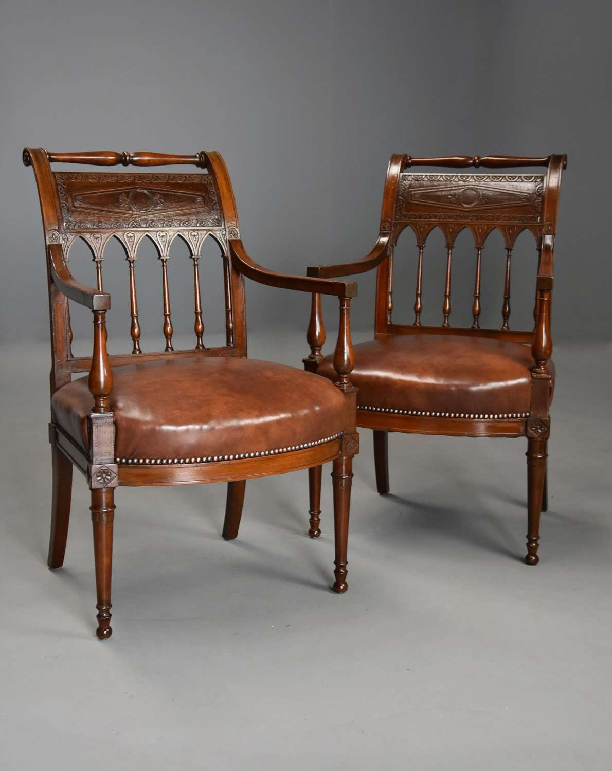 Rare & superb pair of French late 18thc Directoire walnut armchairs